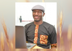 A picture of Odeh Friday, Accountability Lab Nigeria. He's sitting infront of a laptop.